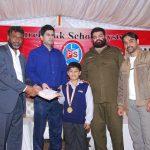 Mr. Amir Karim, Secretary Punjab Chess Association, awarding a cash of Rs. 10,000/- to the Chess Master of U-10 category.