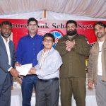 Mr. Amir Karim, Secretary Punjab Chess Association, awarding a cash of Rs. 10,000/- to the Chess Master of U-14 category.
