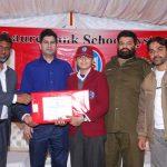 Mr. Amir Karim, Secretary Punjab Chess Association, awarding prize and certificate to a winner of U-14 category.