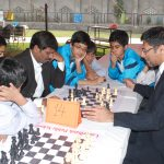 Former Pakistan No. 1 Chess Champion vs.  Pakistan's Ambassador to Bahrain, while the students look on...
