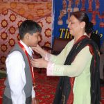 Mrs. Rukhsana Sarwar, advocate High Court, awarding a medal to a winner