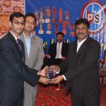 A school representative, receiving participation shield from the Secretary of The Punjab Chess Association