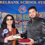Mr. Azhar Ali, the Chief Guest, receiving souvenir from theManaging Director LSS.