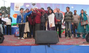 The students receiving trophy for being 2nd in the overall presentation on the occasion of the WWF Nature Carnival 2014.
