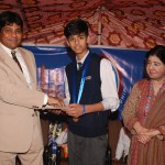 Rana Ifham Sardar from LGS EME receiving gold medal and a cash prize of Rs. 8,000/- for winning the title of The Little Master of Lahore Chess Tournament U-13 age group