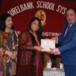 Prof. Dr. Suhail Aftab Qureshi, the chief guest, giving a Gold Medal to a student at the Laurelbank School Prize Distribution.