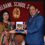 The Chief Guest, Prof. Dr. Suhail Aftab Qureshi, receiving a souvenir from LSS MD Dr. Salma Mian.