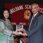 The Chief Guest, Prof. Dr. Asif Ali Qaiser, receiving a souvenir and a copy of the school magazine from LSS MD Dr. Salma Mian.