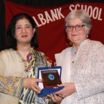 Mrs. Salima Hashmi, The Chief Guest, receiving a souvenir